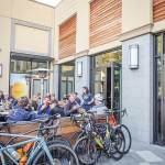 Thumbnail of http://Patrons%20enjoy%20food%20and%20beer%20on%20the%20patio%20outside%20the%20taproom%20at%20Fieldwork%20Brewing%20Company%20in%20Corte%20Madera,%20California