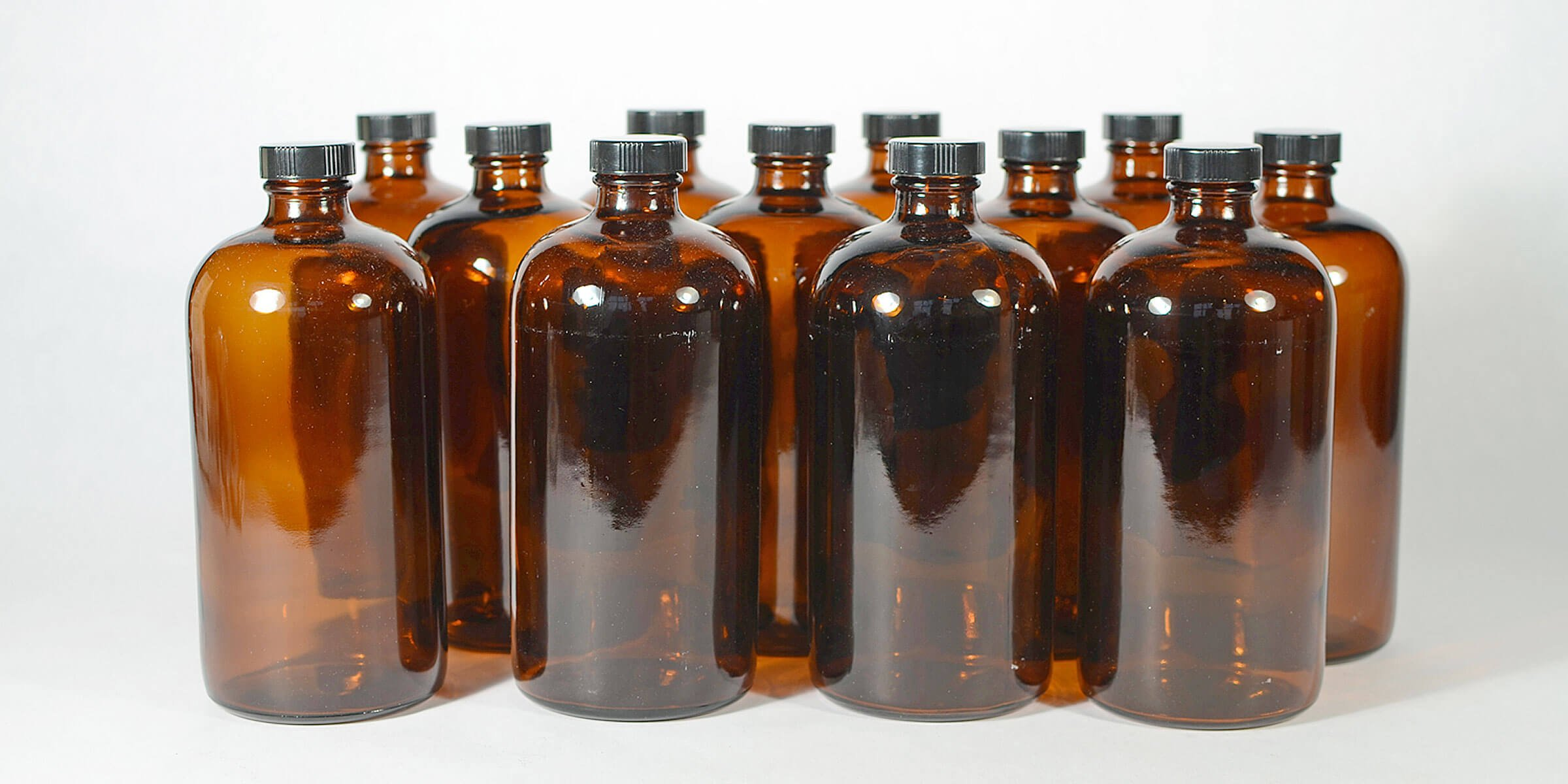 A group of 32 oz. glass growlers