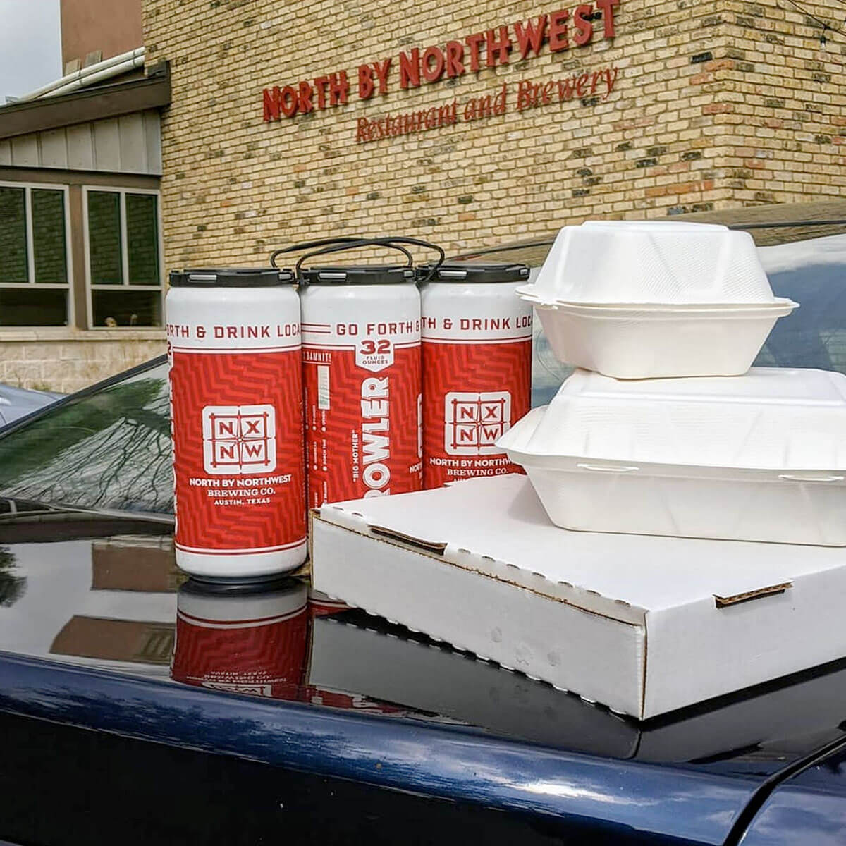 A six pack of crowlers and food-to-go at North By Northwest Restaurant and Brewery in Austin, Texas