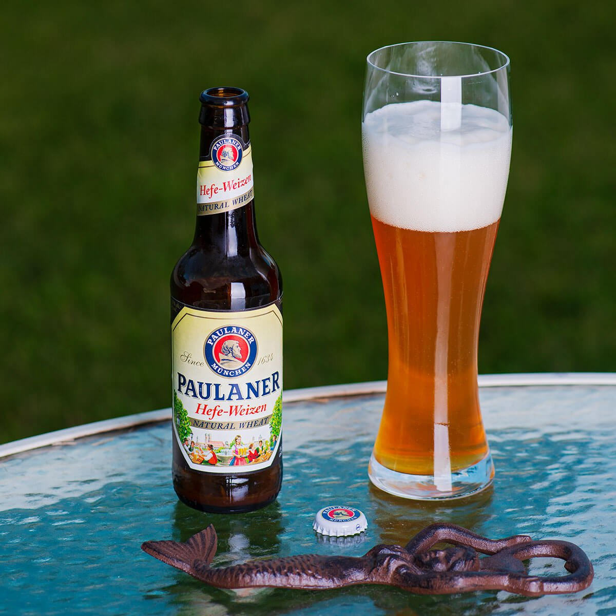 Hefe-Weizen is a German Hefeweizen by Paulaner Brauerei München that balances wheat bread and banana with noble hops and clove.