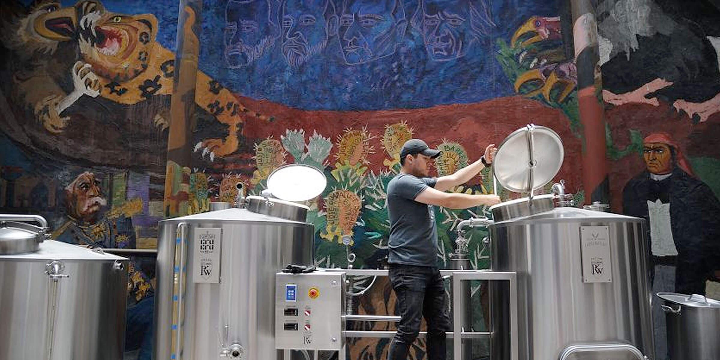 Brewer Armando from Cru Cru Brewery works at the Cru Cru Factory in Mexico City in this June 2017 photo. (Bernardo Montoya / AFP via Getty Images
