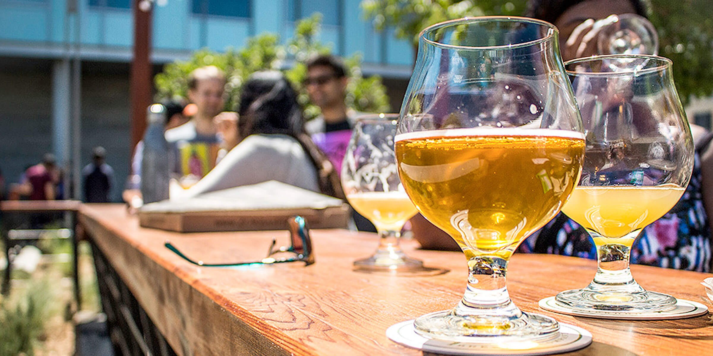 Beers outside on the patio at the Fieldwork Brewing Company location in San Mateo, California