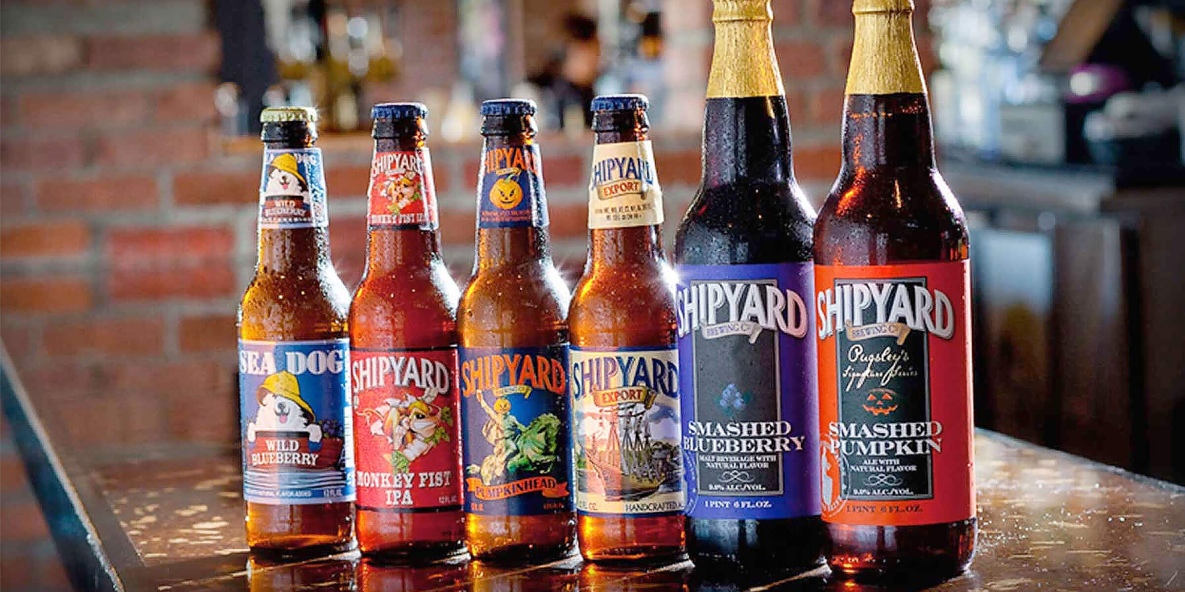 Lineup of bottled beers offered by Shipyard Brewing Co.