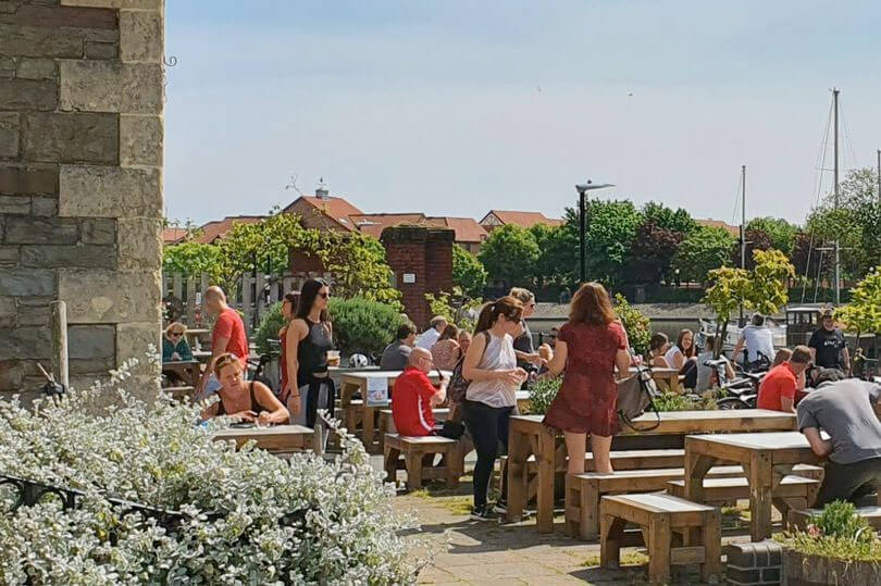 A group of people that didn't practice social distancing gather in the beer garden outside The Pump House, angering onlookers
