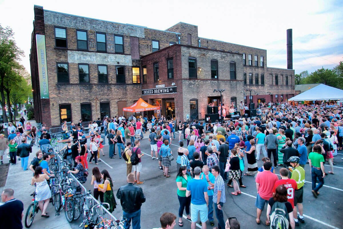 A crowd gathers outside Indeed Brewing Co. in Minneapolis, Minnesota