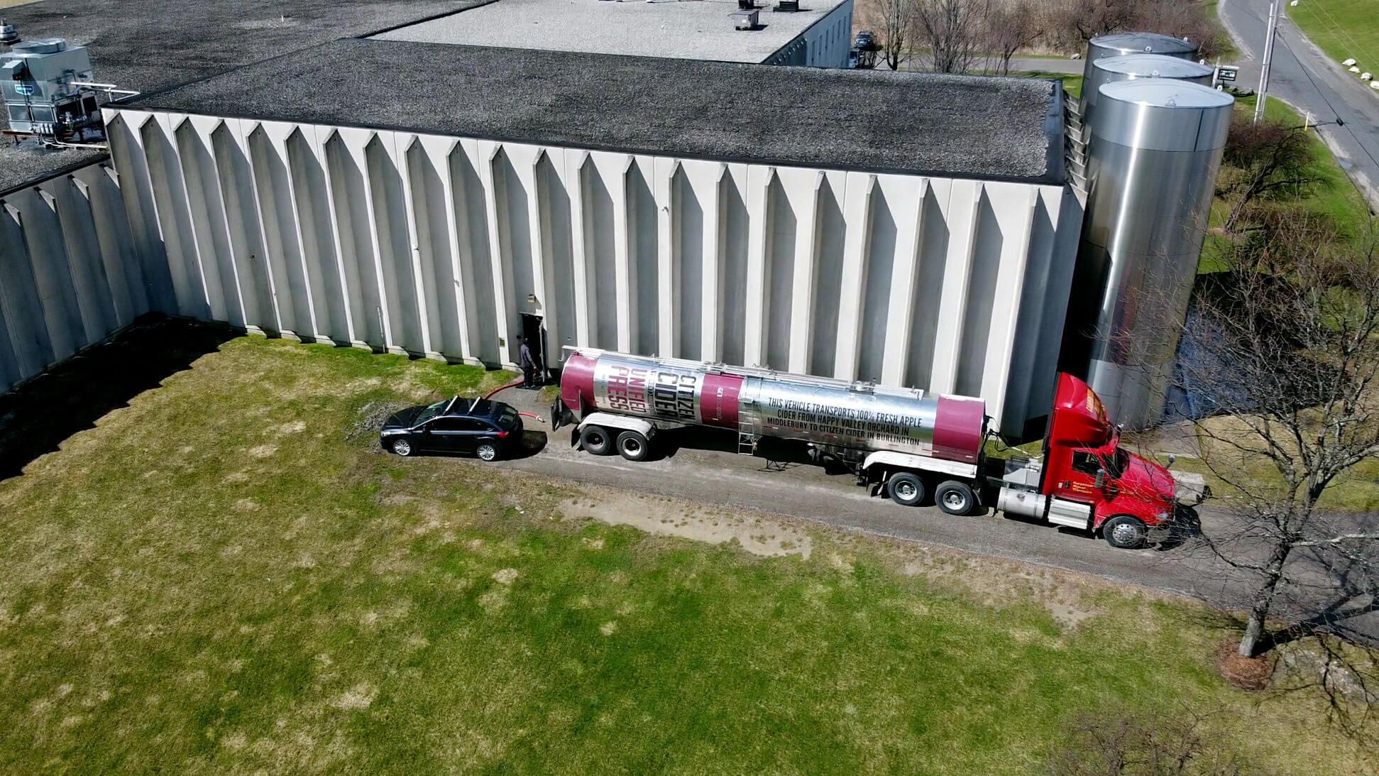 Draft beer is unloaded at Aqua ViTea's facility in Waterbury, Vermont. The beer is put into tall containers, right, and then sent into an alcohol extraction machine.
