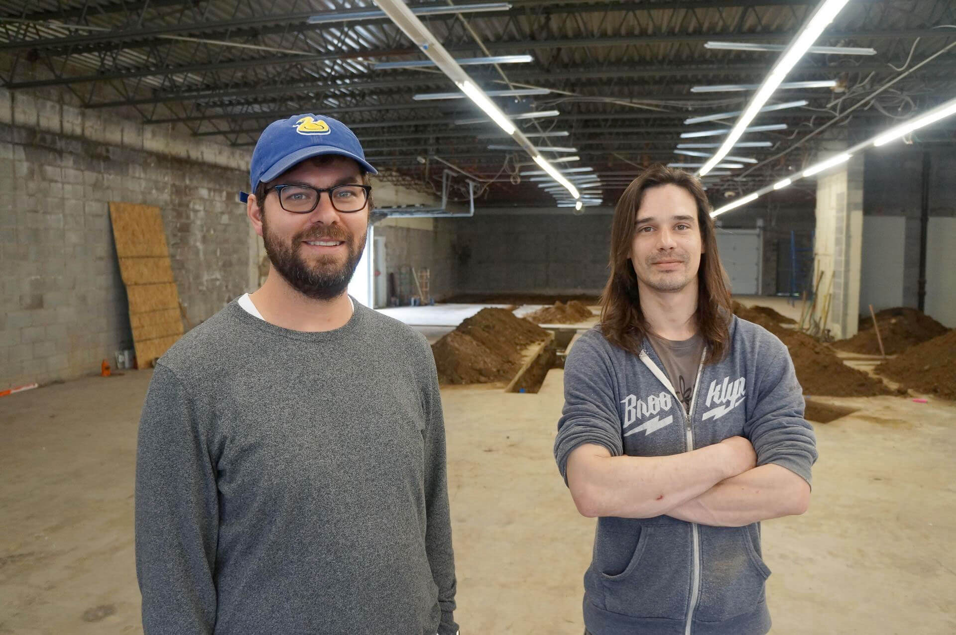 Brighten Brewing founders Elliott Pickett, left, and Tom Robbins stand inside their new brewery that's under construction on Cleveland Massillon Road in Copley Township. The brewery hopes to open in August. [Rick Armon/CantonRep.com]