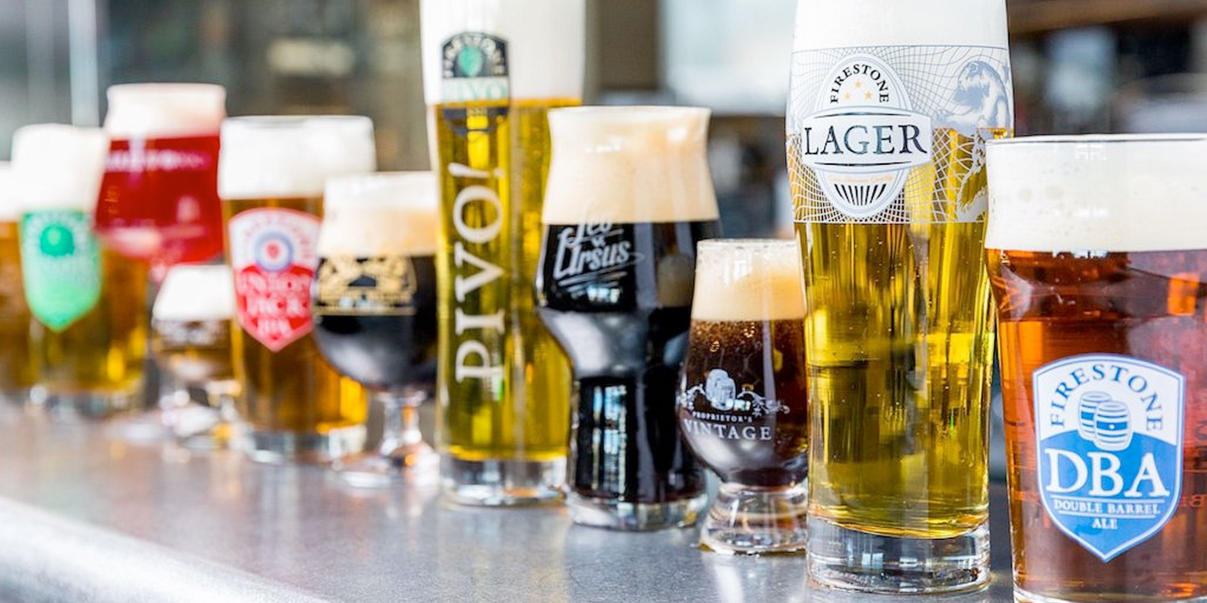 A lineup of beers in assorted Firestone Walker Brewing Company branded glassware