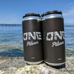 Triceratops Brewing Company teamed up with ONE Manufacturing to craft ONE Pilsner to be enjoyed after hours on the trail, on the water, or on the slopes.