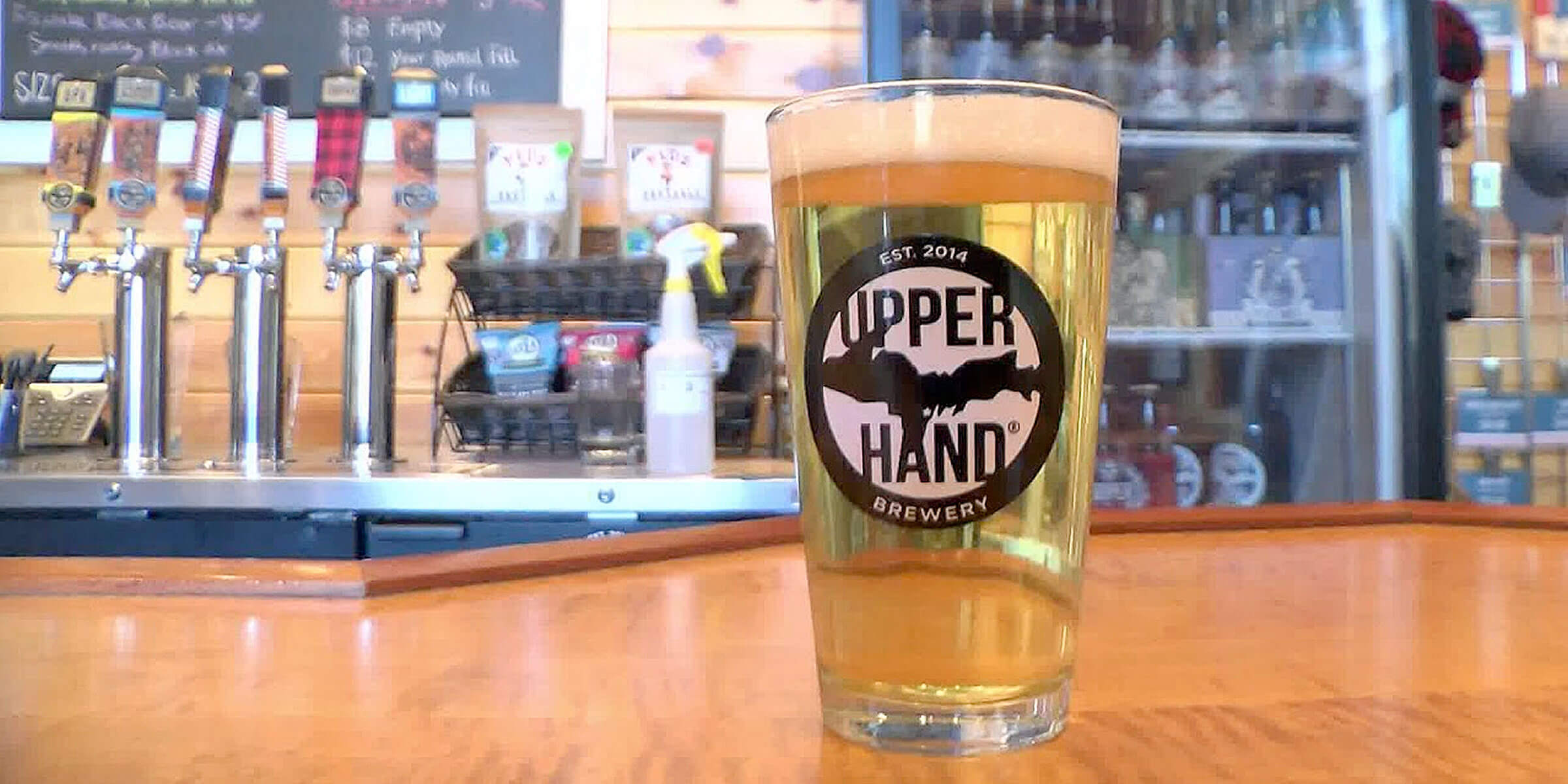 Beer in an Upper Hand Brewery branded shaker pint glass