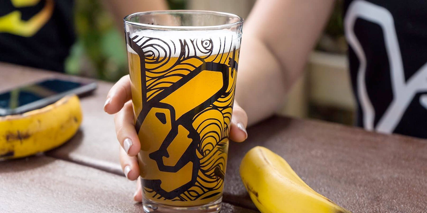 Beer in a Yeasty Brews branded shaker pint glass