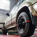 Auto wheel alignment in auto service, SUV maintenance. Car preparing for professional diagnostics