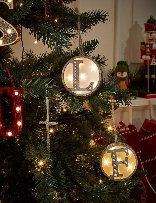 A-Z Hanging LED Lit Wooden Alphabet Baubles. £5.00 Marks & Spencer