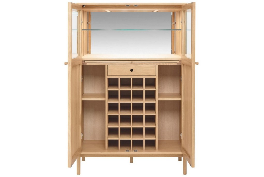 This large drinks cabinet has enough space for 24 bottles of wine and any number of spirits, glasses and associated equipment. The unit is made from oak and has a top compartment that is mirrored that helps give it a lighter feel.