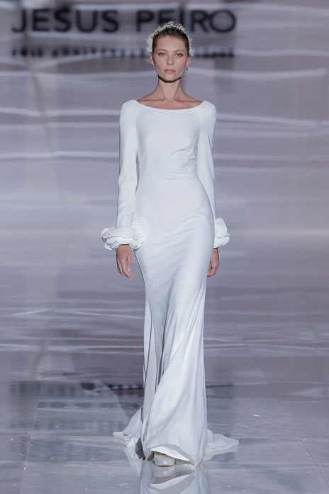 5 White elegance Jesus Peiro Long-established Spanish bridal house Jesus Peiro delivers a masterclass in understated style with this crepe dress. Featuring a wide bateau neckline, low back and long sleeves, it has a beautifully simple and fluid cut and – the only decorative element– fabulous flower petal details at the wrists. jesuspeiro.com