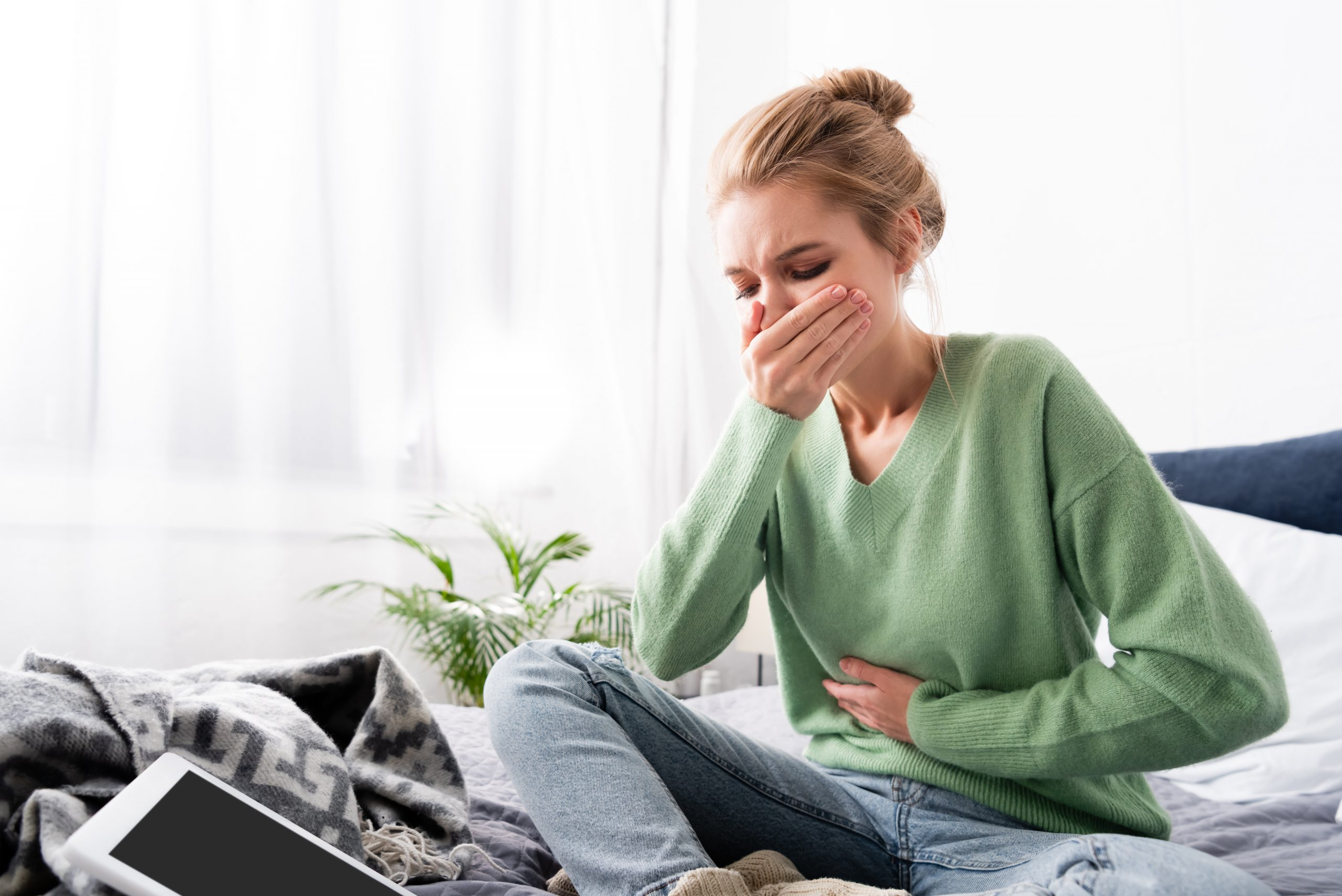 woman having early signs of pregnancy morning sickness nausea