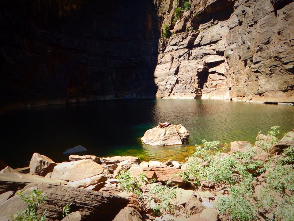 travelling alone, girl in yellow bikini at gorge lake, kakadu national park, australia, northern territory