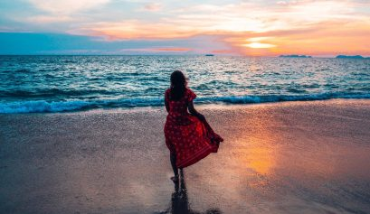 Absolutely Lucy modelling dress from her capsule wardrobe, Koh Lanta beach view, sunset, Thailand 2019