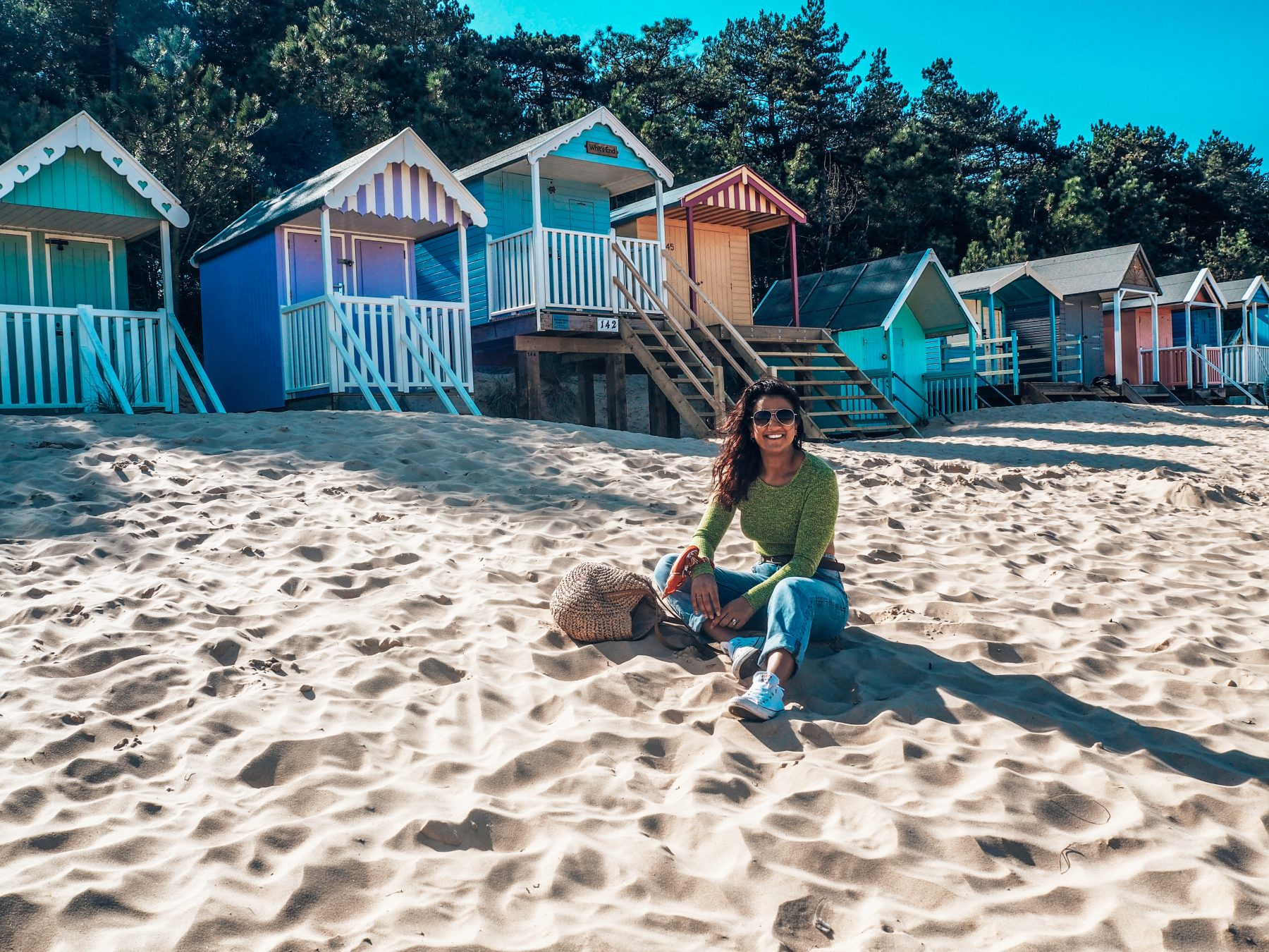 How to save money when you travel with Absolutely Lucy, featuring Wells beach and beach huts, Norfolk