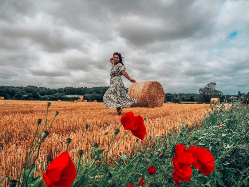 Norfolk holidays take you to the countryside, Absolutely Lucy posing by hay bale