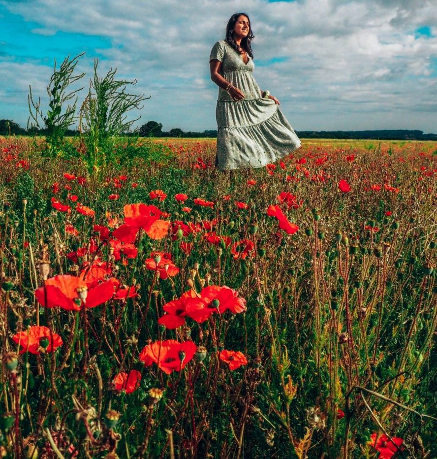 Girl in green dress among the poppies, Norfolk nature parks