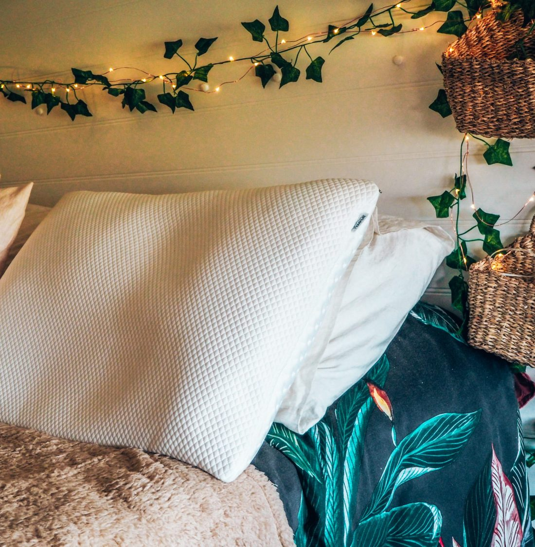 TEMPUR memory foam pillow in camper van with fairy lights and plants, seagrass baskets. best places to sleep