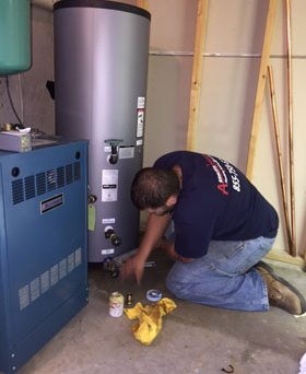 Absolute Precision technician installing a water heater