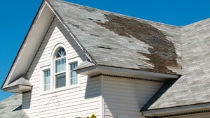 Roof With Damaged Shingles