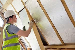 Roofer Installing Attic Insulation