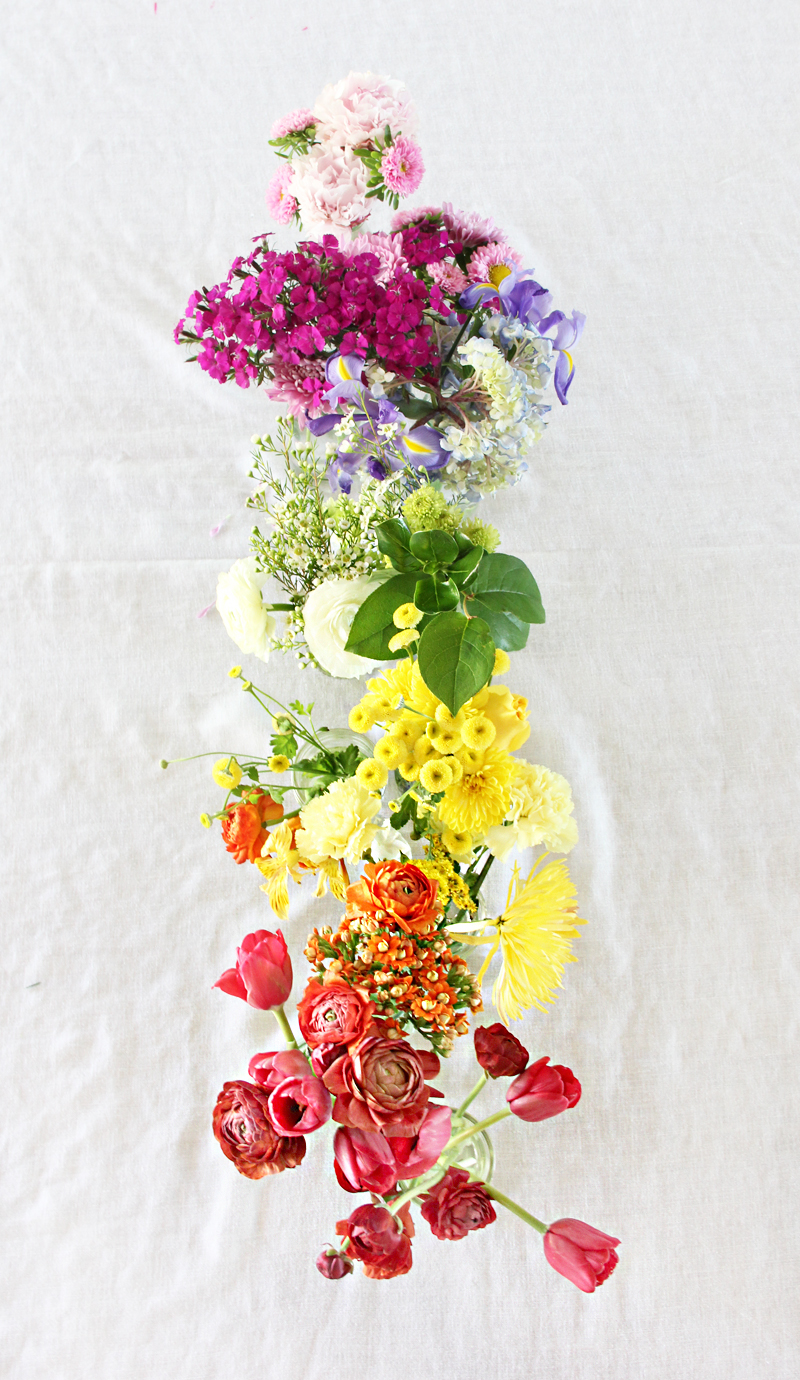 A bubbly lifediy rainbow flowers centerpiece a bubbly life i liked using an assortment of flowers for each color rather than one type of flower i used small glass bottles for vases and lined them up on the table izmirmasajfo Images