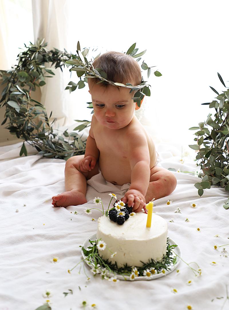 baby reaching for cake