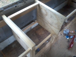 "The stove structure and enclosure. 2x3"" beams and 1/2"" plywood, and some 3/4x2"" pine to keep things even."