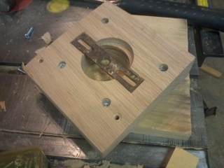Four countersunk screws hold the two pieces of oak together.