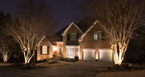 North Atlanta home with up-lighting on house and trees.