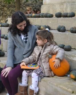 little girl and her pumpkin crop