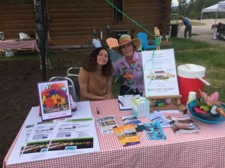market manager and her granddaughter at table