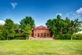 image of historic brick building and green summer lawn