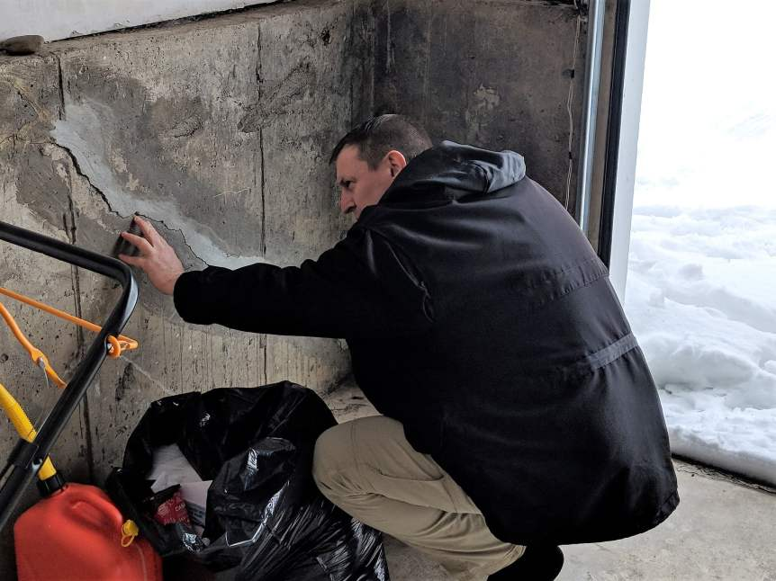 Adam Anderson - Inspector - Inspecting foundation cracks