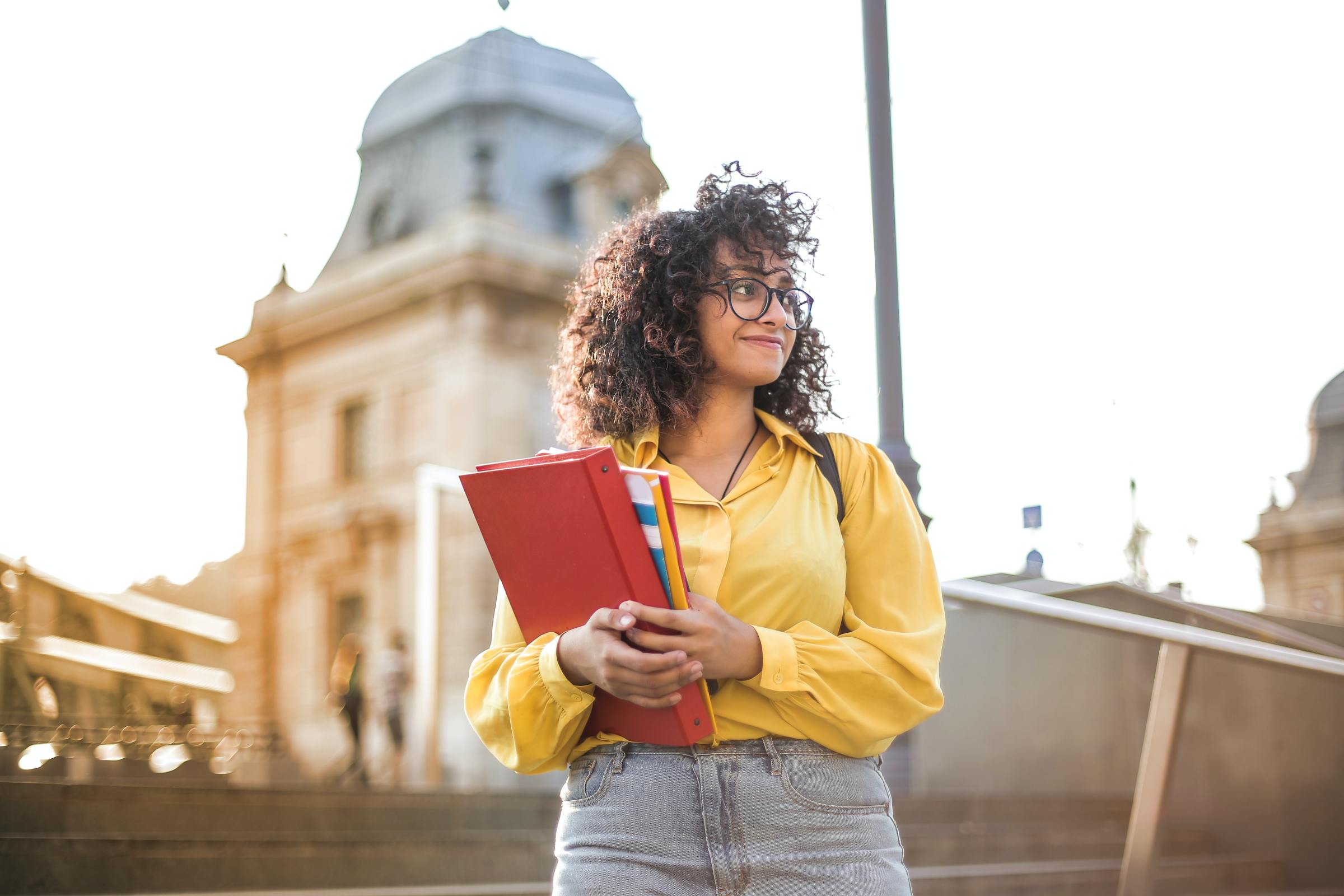 woman going back to college holding books