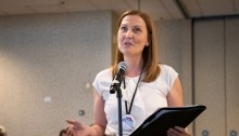 Terminated St. Edward's University faculty member Corinne Weisgerber speaking at the AAUP annual meeting.