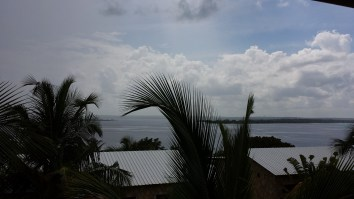 Deep and dark clouds brood over an overcast port in Nacala.