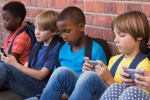 school children on smart phones