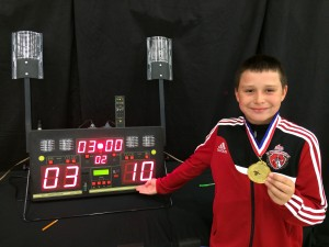 Bartosz Kuligowski proudly shows his final bout score at Y10 Men's Epee at North Texas SYC August 31 2014