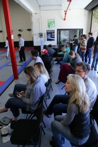 Parents cheer fencers during fencing competition