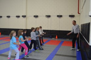 Young 7 years old fencers at the fencing lesson