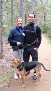 Carolina Garces, left, and James Falzarano, right, both of Boston, are shown during a hike with Olaf, a mixed Blue Lacy and Australian Stumpy Tail Cattle Dog.