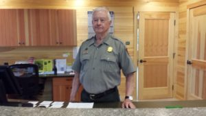 Ranger Bill Jones stands inside the Schoodic Woods Ranger Station at Acadia National Park.