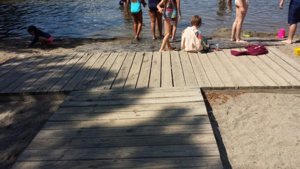An accessible boardwalk goes to the shore of Echo Lake in Acadia National Park.