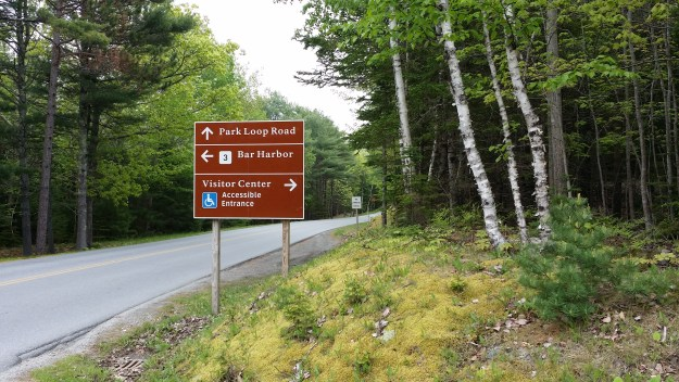 A sign for a separate accessible entrance to the Hulls Cove Visitor Center at Acadia National Park.