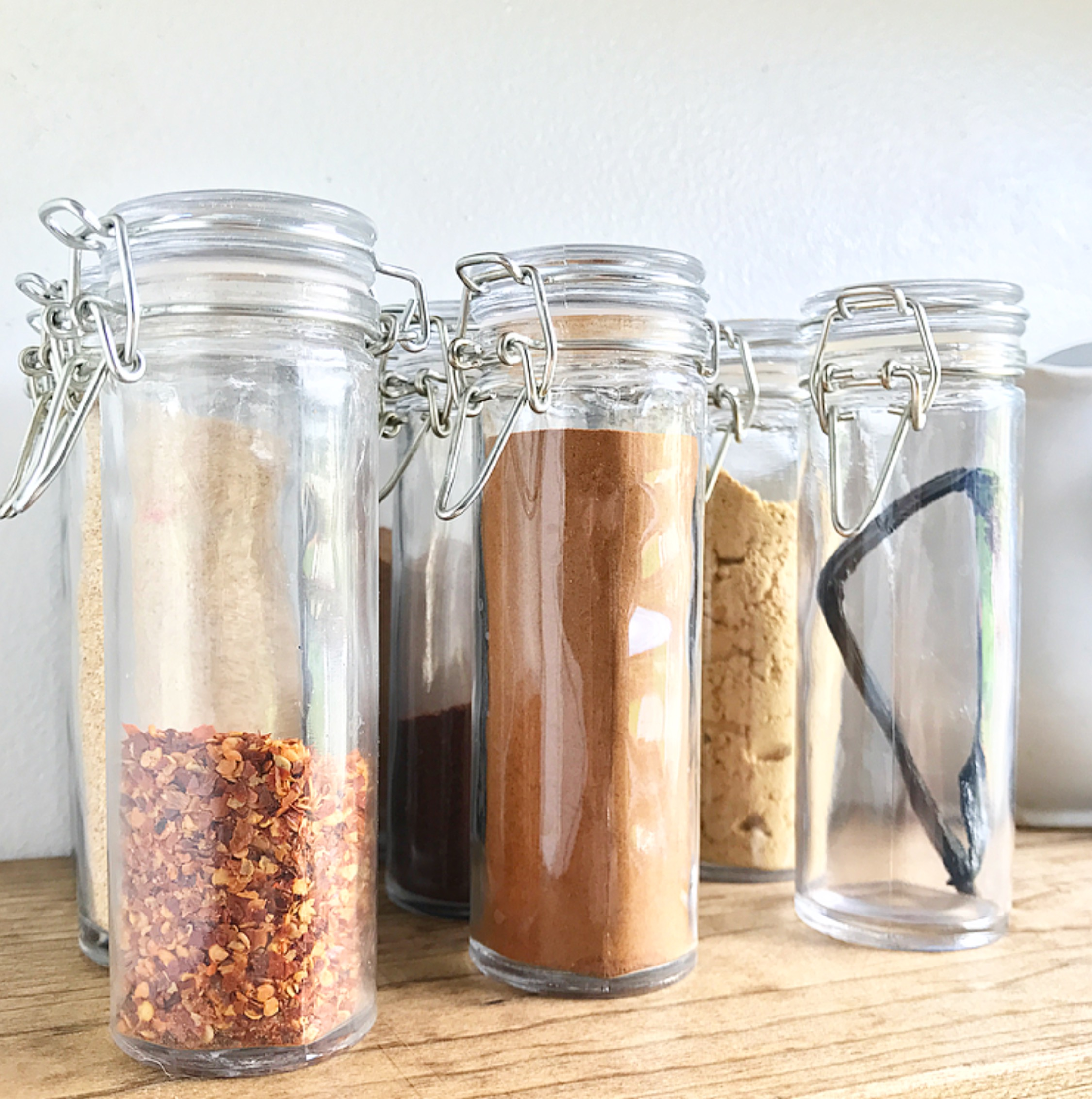 Space in the kitchen by adding shelves and glass canisters with seals - I Have Never Been Big On Labels Especially Since I Am Always Changing Things Up So I Opted For A Cleaner Look However I Still Need To Know What Spice Is